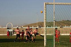 Teens playing soccer at Ghazi Stadium.