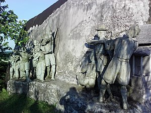 Tezpur - A bas-relief displaying a historical incident at Kankalata Udyan, Tezpur