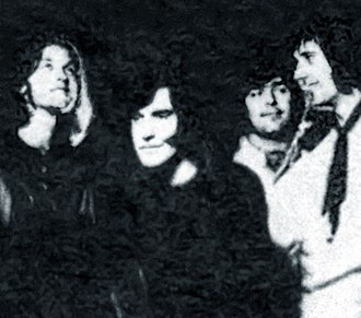 The Kinks - With the newly hired John Dalton in 1969. From left: Dave Davies, Ray Davies, Dalton, Mick Avory