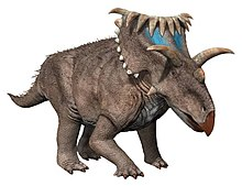 Computer rendering of a gray, quadrupedal dinosaur with many horns