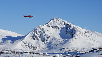 Kulusuk Airport - Air Greenland Bell 212 helicopter approaching Kulusuk Airport on the way from Tasiilaq