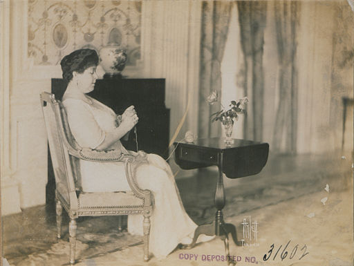 Lady Hendrie in a sitting pose, knitting (HS85-10-31602)