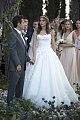 Lana Zakocela holds hands with Justin Etzin at their wedding (2015).jpg