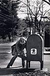 Letter Carrier Retrieving Mail (2551042476).jpg