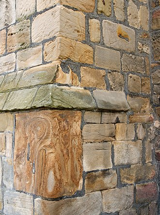 St Mary and St Cuthbert, Chester-le-Street - Stones with lewis holes in a front buttress.