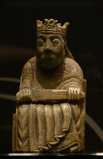 Guðrøðr Óláfsson - A king gaming piece of the so-called Lewis chessmen. Comprising some four sets, the pieces are thought to have been crafted in Norway in the twelfth- and thirteenth centuries. They were uncovered in Lewis in the early nineteenth century. Some of the pieces may have arrived in the Isles as a result of Guðrøðr's return from Norway.