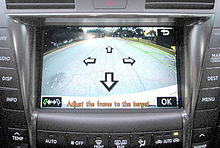 Rear camera view showing street on a car screen.