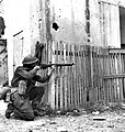 Loyal Edmonton Regiment soldier firing at German position Ortona December 1943.jpg
