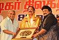 M. Venkaiah Naidu being presented a memento by Shri Ramkumar Ganesan and Shri Prabhu (sons of legendary Actor Late Sivaji Ganesan), at the 88th birthday celebrations of the Actor late Sivaji Ganesan, in Chennai.jpg