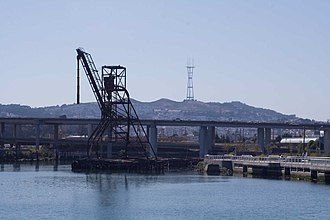 Islais Creek - Islais Creek with an abandoned five-story-high copra crane, Interstate 280 and Sutro Tower in the background