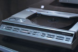 LaserDisc - A top-loading, Magnavox-branded LaserDisc player with the lid open.
