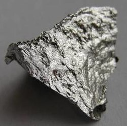 A rough fragment of lustrous silvery metal
