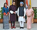 Manmohan Singh and his wife Smt. Gursharan Kaur with the King of Bhutan, His Majesty Jigme Khesar Namgyel Wangchuck and the Bhutan Queen, Her Majesty Jetsun Pema Wangchuck, in New Delhi on October 24, 2011.jpg
