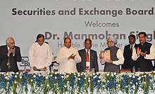 "Manmohan Singh releasing a book on the History of Indian Securities Market ""Banyan Tree to e-trading"", at the Silver Jubilee Celebrations of the Securities and Exchange Board of India (SEBI).jpg"