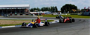 1991 British Grand Prix: Nigel Mansell giving Ayton Senna a lift back to the Paddock at Silverstone, he had run out of fuel and Mansell won the race and then gave him the lift on the Victory Lap.