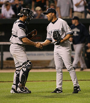 Jorge Posada - Posada (left) greets Mariano Rivera at the end of a game.