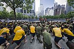 Marines and Sailors kneel during a moment of silence at the National September 11 Memorial & Museum. (34148330214).jpg