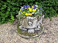 Medieval font in All Saints Churchyard - geograph.org.uk - 948211.jpg
