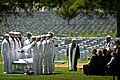 Members of the U.S. Navy Ceremonial Guard fold the American flag over the casket bearing the remains of sailors killed in the Vietnam War during a graveside interment ceremony at Arlington National Cemetery 130502-N-MG658-012.jpg