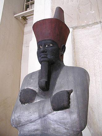 Mentuhotep II - Painted sandstone seated statue of Nebhepetre Mentuhotep II, Egyptian Museum, Cairo.