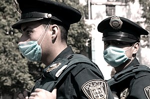 Mexican police officers with masks on swine flu