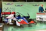 Minardi pits at the 1994 British Grand Prix (32541363915).jpg
