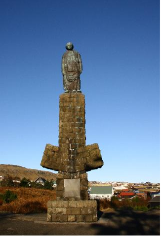 British occupation of the Faroe Islands - Minnisvarðin, in honour of the 210 men who died at sea during World War II. Erected in 1956, made by Kaare Orud (Norwegian artist), Lamhauge and Waagstein, Jacob Simonsen, the stoneplates were made by the Føroya Mekaniski Grótídnaður.
