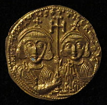 A picture of a gold coin, bearing an image of Tiberius IV and his father Justinian II on its reverse side.