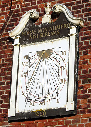"Moot hall - Sundial on Moot Hall, Aldeburgh, Suffolk, England. The motto translates as ""I count only the sunny hours""."