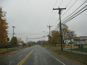 New York State Route 31E - NY 31E eastbound in Middleport. Although this section is county-maintained, reference markers remain posted along the road, as seen here.