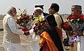 Narendra Modi being received by the Governor of Madhya Pradesh, Shri Ram Naresh Yadav, the Chief Minister of Madhya Pradesh, Shri Shivraj Singh Chouhan and the Union Minister for External Affairs, Smt. Sushma Swaraj.jpg