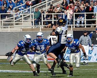 Quarterback sack - A quarterback under pressure.