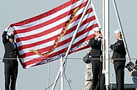 The First U.S. Naval Jack hoisted aboard the USS Kitty Hawk (CV-63) on December 23, 2001