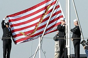 Jack (flag) - The current United States naval jack being hoisted on the USS Kitty Hawk on 23 December 2011