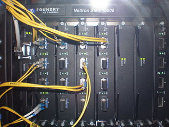 10 Gigabit Ethernet - A Foundry Router with 10 Gigabit Ethernet optical interfaces (XFP transceiver). The yellow cables are single-mode duplex fiber optic connections.