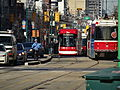 New streetcar 4404 passes old CLRVs, 2014 12 20 (1) (16072769545).jpg