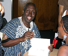 Ngũgĩ wa Thiong'o signs copies of his book Wizard of the Crow, at the Congress Centre in central London. Wizard was his first book in 20 years, following 22 years of exile due to his political work.