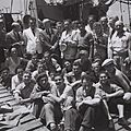 "OFFICIALS OF THE JEWISH AGENCY, AMONG THEM MOSHE SHAPIRA (STANDING 3RD FROM LEFT) RECEIVING IMMIGRANT REFUGEES FROM EUROPE ON BOARD OF THE ""MATAROA"" ID820-064.jpg"
