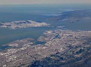 Alameda, California - Aerial view of Alameda Island (center), with Oakland in the foreground and San Francisco behind