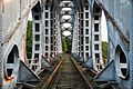 Old railway bridge over the canal in Gellik Belgium.jpg