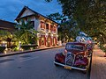 Old red Citroen near hotel 3 Nagas at blue hour in Luang Prabang.jpg