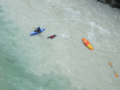 Overturned canoe in river Soča.png