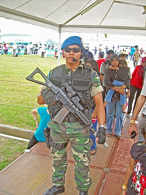 PASKAU - The Force Protections Team personnel from PASKAU armed with SIG SG – 553SB assault rifle, on guard at Langkawi International Airport during the Langkawi International Maritime and Aerospace Exhibition 2009 or LIMA 2009.