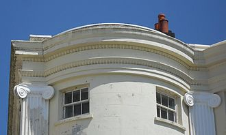 Buildings and architecture of Brighton and Hove - 102 Marine Parade has such Regency-style features as a bow-fronted stuccoed façade, fluted Ionic pilasters, decorative capitals and a parapet.