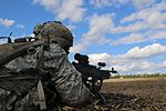 Paratrooper fires a machine gun in live-fire exercise 160302-A-YM156-036.jpg