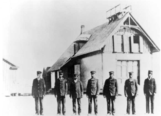 Pea Island Life-Saving Station - Keeper Richard Etheridge (on left) and the Pea Island Life-Saving crew in front of their station, circa 1896