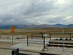 Pedestrian level crossing at South Jordan Parkway station, Apr 16.jpg