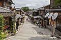 Pedestrian road with pavements, paper umbrellas and people in yukata, Higashiyama-ku, Kyoto, Japan.jpg