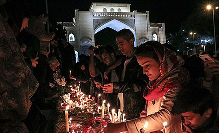 People in Shiraz light candles at Quran Gate People in Shiraz turn on the candle for victims of 2019 Shiraz floods 1.jpg