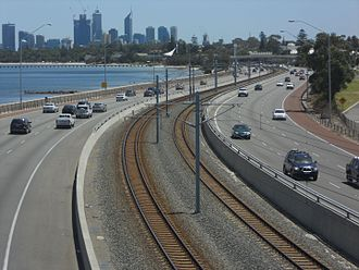 Kwinana Freeway - View facing north at Como, showing the Mandurah railway line in the freeway median